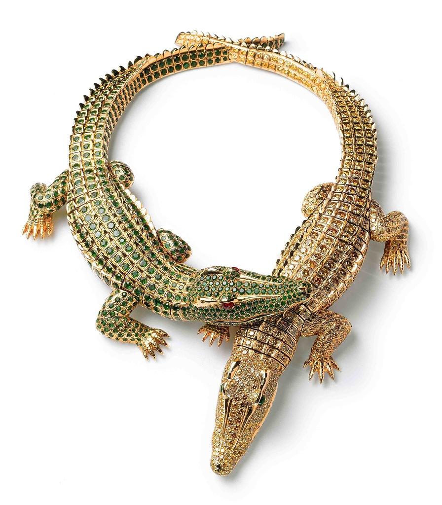 Crocodile Necklace, Cartier Paris, 1975, gold, 1,023 brilliant-cut yellow diamonds, two navette-shaped emerald cabochons (eyes), 1,060 emeralds, and two ruby cabochons (eyes).